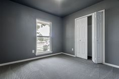 Modern bedroom. Gray walls. Gray carpet. Remodel. modernelan.com