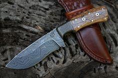 Meteorite damascus with mammoth ivory handles  www.hhhcustomknives.com