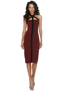For a sensationally seductive hourglass figure choose this beautiful evening or cocktail dress  to turn heads everywhere. This backless dress has an unusual halter neckline and gorgeous buckled back detail. Stunning!