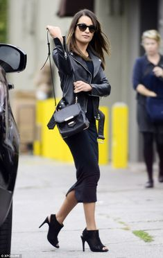 So chic: Lea Michele looked gorgeous in a leather jacket and clinging black dress as she h...