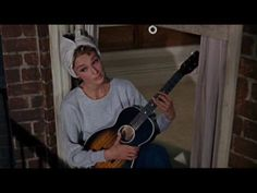 Audrey - singing: 'Moon River' from Breakfast at Tiffany's