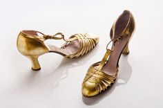 These pretty snappy gold leather shoes are from the 1930s.