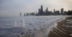 A frozen Lake Michigan sits still in front of the Chicago skyline. Chicago felt a record low temperature of -16 degrees Fahrenheit on Monday.