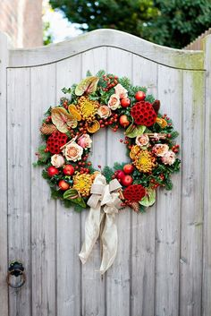 beautiful flowers and berries wreath, a good decor on the door or for a winter wedding