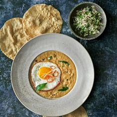 Ravinder Bhogal's crispy fried eggs with coconut curry and coriander sambol | Curry | The Guardian Curry Dishes, Vegan Dishes, Indian Cheese, Best Curry, Tomato Curry, Massaman Curry, Pumpkin Curry, Lamb Curry, Midweek Meals