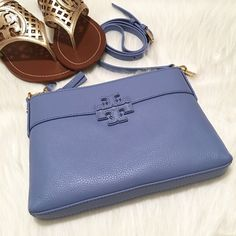 """NWT Tory Burch Stacked T Small Crossbody Bag! NWT Tory Burch Stacked T Small Crossbody Bag! Color: Blue Dusk. Comes with TB bag dust pouch. """"Travel light this season with Tory Burch's well-sized crossbody, featuring rich-looking logo detailing and a convertible strap."""" -Leather -Imported -Detachable crossbody strap -Zip closure; lined -Interior zip pocket -8""""L x 0.75""""W x 6""""H; 23"""" strap drop Tory Burch Bags"""