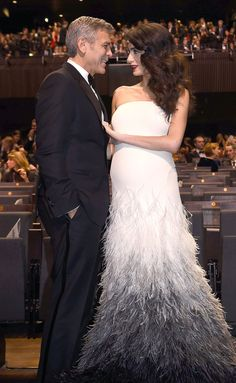 Expectant twin mama Amal Clooney was at the side of husband George Clooney Friday. Beautiful couple!!
