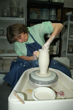 Introducing Antoinette as a ceramic teacher and teaching how to throw a tall bottle.