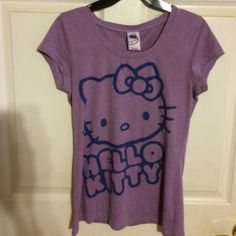 Purple Hello Kitty Top. This is a cute little t-shirt. It is soft and comfy. Sanrio Tops Tees - Short Sleeve