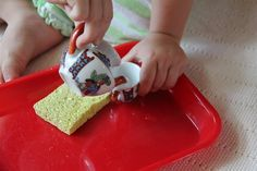 Learning to Pour Water. Like the little tea pot and cup. Don't forget the sponge.