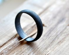 A modern, masculine wedding band made from oxidized silver. #etsyweddings