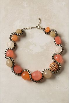 Anthropologie's bead and chain necklace. Head to your local craft store for supplies to fashion a knock-off.