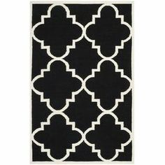 Hand-woven wool and cotton rug with a quatrefoil motif. Made in India.  Product: RugConstruction Material: Wool and cottonColor: Black and ivoryFeatures:  Made in IndiaHand-wovenFlatweave  Note: Please be aware that actual colors may vary from those shown on your screen. Accent rugs may also not show the entire pattern that the corresponding area rugs have.Cleaning and Care: Professional cleaning recommended