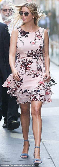 Good mood: Ivanka Trump is all smiles in a pink, floral print dress as she leaves her apar...