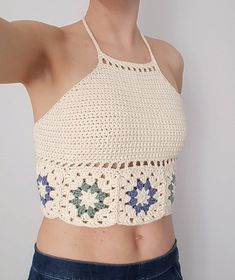 Free Crochet Pattern for Hepatica Granny Halter Top by Hooked by Anna. A quick-to-make halterneck top that starts as a row of granny squares. Free Pattern More Patterns Like This!