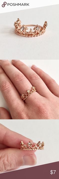 Rose Gold Crown Ring Size 6 Fit for a queen. This lovely crown ring in a rose gold color is so pretty. Accented with clear rhinestones. Size 6. Brand new and never worn. Not intended for children under 12. Jewelry Rings