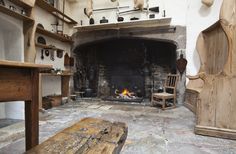 The hearth and fireplace in the Kitchen at Cotehele, Cornwall. | National Trust Images