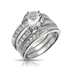 Measure:  Each band is 2mm wide, Center stone is 9mm  Weight:   Total weight is 8.5 grams  Material:  .925 Sterling Silver, Rhodium Plating, Cubic Zirconia