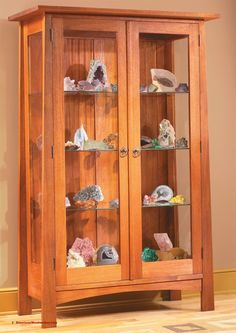 Display Cabinet Open sides and built-in lights showcase your treasures. By Randy Johnson Some cabinets are all about displaying the beauty of wood. This cabinet, with its glass doors, shelves and sides and built-in lighting, is all about displaying what's inside. Whether it's your collection of antique tools or fine porcelain, whatever you put inside is sure to shine. You may also like… Show Case Sliding Door Bookcase Modern Mission …
