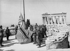"""German soldiers raising the swastika flag on top of the Acropolis , the symbol of Ancient Greek Democracy captured on 23 April 1941 by the Nazis. Greek History, World History, World War Ii, Luftwaffe, Ancient Greek Democracy, Old Greek, German Soldiers Ww2, German Army, Athens Greece"