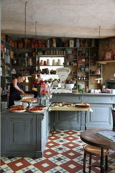 vintage interior design--I love the slate blue counters and the rustic vibe.