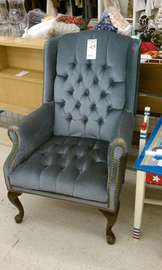 Reupholstering a wing-back chair, with buttons
