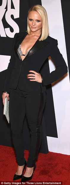 Miranda Lambert showed off ample cleavage in a black suit and gem-encrusted bra on the red carpet at Fashion Rocks 2014 http://dailym.ai/WTFhQR