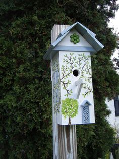 Traditional White Ivy Covered Cottage Style Decorative Birdhouse. $79.00, via Etsy.