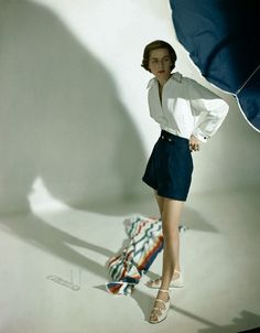 1948    Model is wearing a long white shirt, blue Crompton corduroy swimming shorts and bra by Carolyn Schnurer.