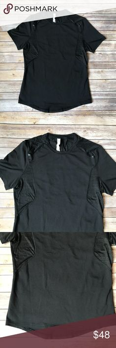 Lululemon Black Metal Vent Tech Short Sleeve Shirt EUC black shirt from Lululemon - not 100% on the exact style but similar in style. Has vents on the sides and upper back.  Has a small zipper pocket on the side (pictured).  Lightweight, sweat-wicking, and four-way stretch short sleeve. Black and parts of the black has gold stitching woven onto it which is pictured.  Body Material is 69% polyester, 21% nylon, 8% Spandex 2% X-Static Silver Nylon  Contrast  Material 91% Nylon, 5% X-Static…