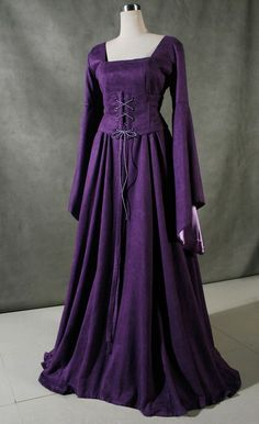 simply styled medieval gown... easy to picture a refashion of a modern dress. Add a scarf, lacing, and sleeves