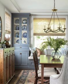 The contemporary lighting, antiques, and colored cabinetry work beautifully in this dining room. Luxury Homes Interior, Interior Exterior, Home Interior, Sweet Home, My Living Room, Living Spaces, Contemporary Light Fixtures, Contemporary Chandelier, Traditional House