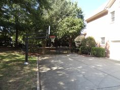 This side view shot shows a Pro Dunk Gold Basketball system installation under the shade of these North Carolina trees. Ample room for practice is provided by the concrete driveway.