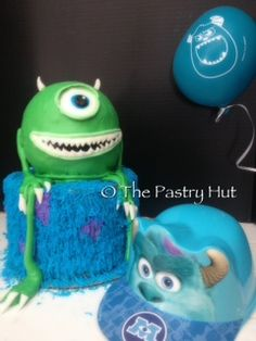 Monsters Inc two tiered birthday cake with Mike Wazowski www.facebook.com/thepastryhut
