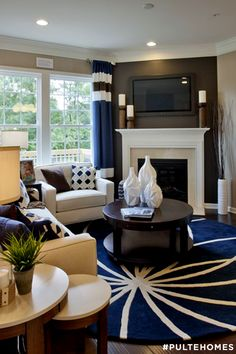 Midwood Square is a great community that offers a walkable lifestyle with close proximity to dining, shopping and nightlife in the Plaza Midwood/Elizabeth area of lovely Charlotte, NC. Offering two different models, this community is made for those who enjoy urban luxuries and modern design. It's easy to imagine curling up to next to the fireplace in this beautiful living room with a nice pop of color. | Pulte Homes