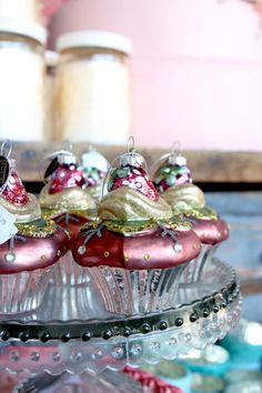 Delectable cupcake ornaments dressed up in eclectic candy inspired colors  | Holiday 2013 | Rolling Greens