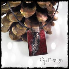Necklace ethnic style, plate of worked and enamelled copper red deep - lace leather