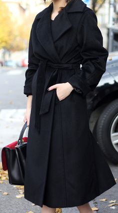 Vanja Milicevic is wearing a black robe coat from Max Mara