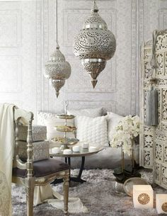 Gorgeous silvers, whites and grays are the perfect palette in this global inspired living room space.