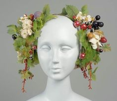 Woman's headdress, French, worn in Boston, mid-19th century. MFA, 51.360. Headdress on wire with pendant masses of artificial cherries, strawberries, grapes, plums, blossoms, leaves and coral at each end of wire.