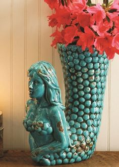 The Large Turquoise Ceramic Mermaid Vase is an exquisite nautical decor offered at a low price at Everything Nautical. Since 1998. Satisfaction guaranteed.