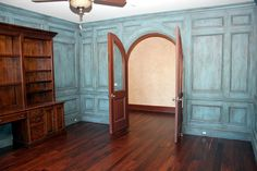 Pillow-scraped walnut hardwood with great antique faux finish on the walls.