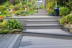 Low maintenance stone grey and black composite decking Team Online, Decking Area, Timber Deck, Cold Frame, Can Run, Composite Decking, Grey Stone, Eco Friendly, Composition