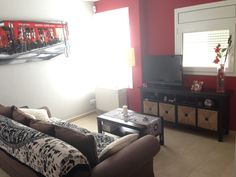 Salon de invierno, con decoración en base a rojos gracias a Totpint
