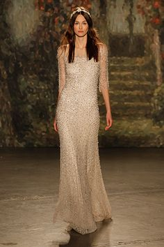 William Shakespeare's A Midsummer Night's Dream served as the impetus behind Jenny Packham's otherworldly collection. Vintage-glam with delicate, all-over beadwork, this style is fit for a fairy queen.