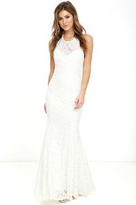 With a flower in your hair, and a pretty smile, you'll be absolutely irresistible in the Beneath the Garden Arbor Ivory Lace Maxi Dress! A breathtaking ivory lace overlay with ornate appliques, descends from the straps of the squared-off neckline into a princess-seamed bodice. Elastic secures the strappy open back, while ruffling tiers of crocheted and eyelet lace trim the full, maxi-length skirt. As Seen On Carmella of @melwitharosee, Hanna of Hanna Montazami blog and Emily of…