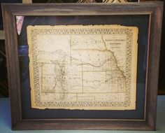 Custom framed map floated on top of the mat to highlight the tattered edges. Come see how we can make your vintage map look amazing! #art #pictureframing #customframing #denver #colorado