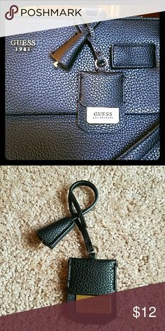 GUESS Hang Tag Keychain! Brand new, never used GUESS brand hang tag for your purse! Can also be used as a keychain. Black leather material with champagne gold hardware. Guess Accessories Key & Card Holders