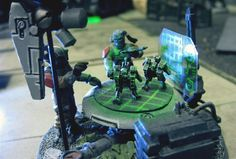 This is a cool little objective or background piece.  Urban camo Tau Empire army by An00bis / Jason Horsley