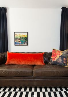 """Negative space: Using negative space on your walls can pull your eye to a focal point. By leaving part of your wall """"empty,"""" you make the art that is hanging stand out even more. But you can play the same game with your sofa; experiment with only one or even none when it comes to throw pillows to see how negative space adds interest."""